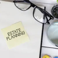 estate planning written on a sticky note