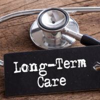 long term care sign with a stethoscope